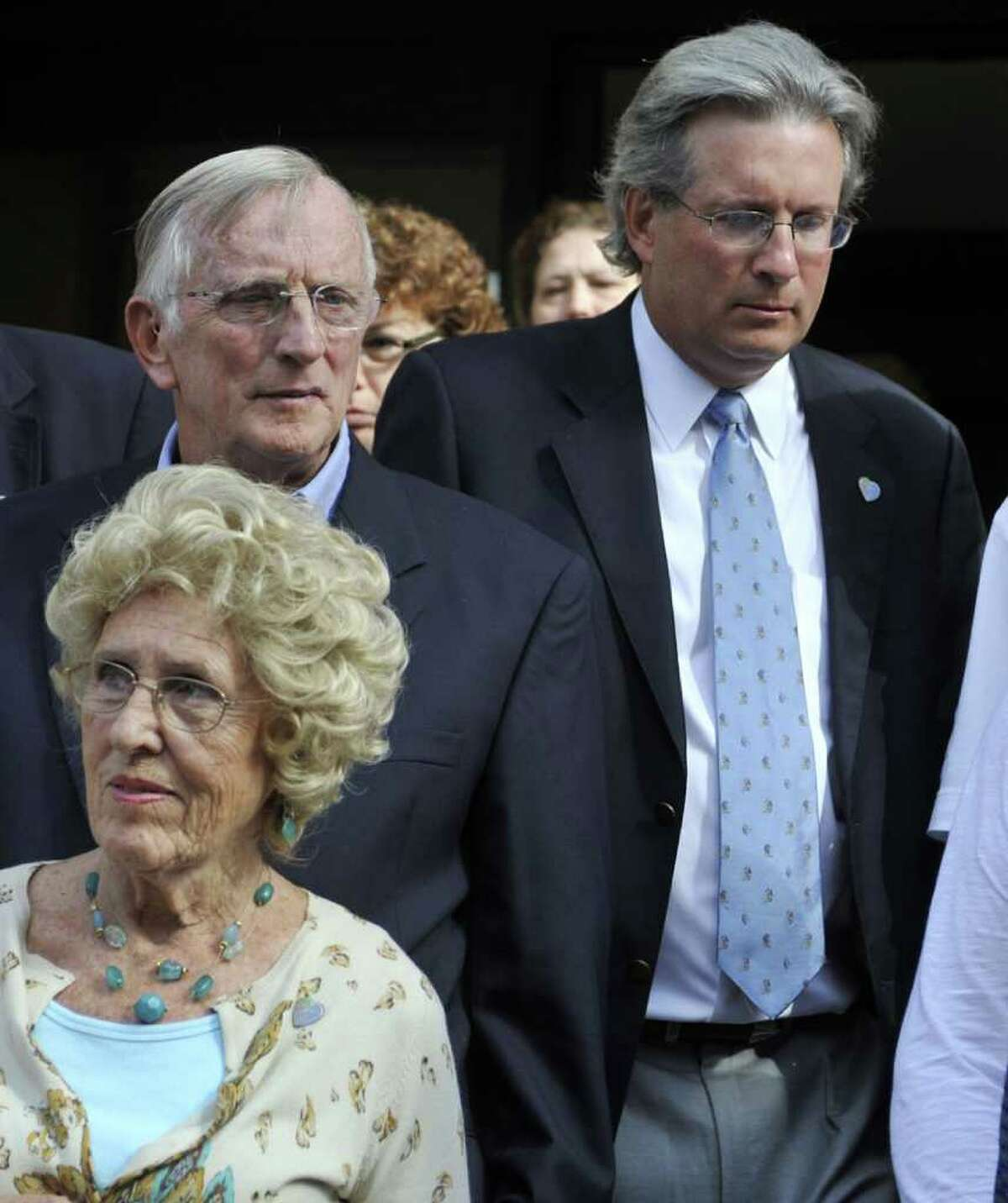 Dr. William Petit Jr., right, leaves court with his father, William Petit, left, and his mother-in-law Marybelle Hawke, bottom left, after the first day of the trial of Steven Hayes at Superior Court in New Haven, Conn., on Monday, Sept. 13, 2010. Prosecutors allege Hayes and Joshua Komisarjevsky killed Jennifer Hawke-Petit and her two daughters, 17-year-old Hayley and 11-year-old Michaela, in their Cheshire, Conn. home in July 2007. (AP Photo/Jessica Hill)