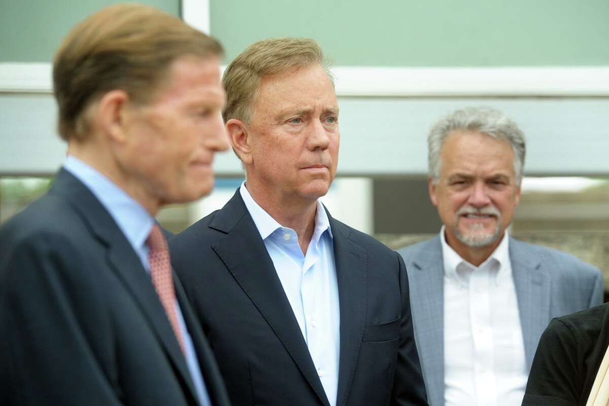 """Governor Ned Lamont attends a news conference at the Stratford rail station, in Stratford, Conn. June 21, 2021. Lamont was joined by other federal, state and local leaders to announce """"Time for CT"""", an new plan to improve passenger and commuter rail service in Connecticut."""