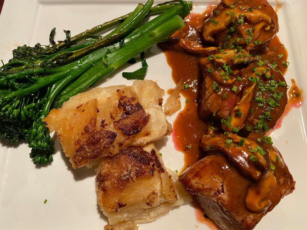 Medallions of filet mignon with potatoes au gratin and broccolini at Farmhouse Tap + Tavern in Altamont. (Susie Davidson Powell/for the Times Union.)
