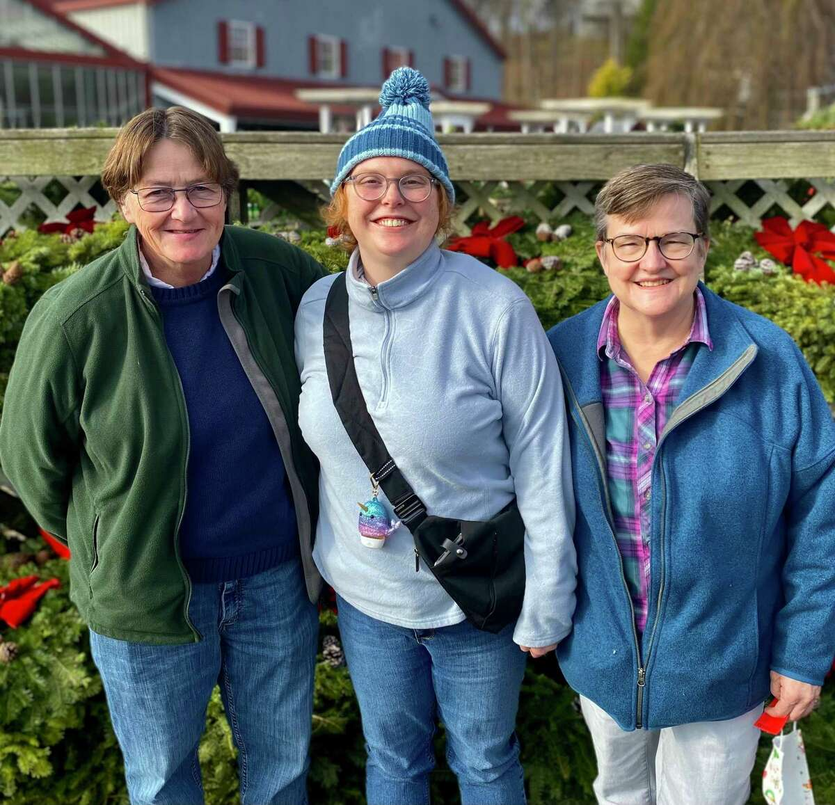 Madison resident Elizabeth Gardner, who has an exceedingly rare genetic condition, is raising money for a nonprofit that will be providing her with a service dog trained to fit her needs. She's flanked by her mothers Catherine Griffith, left, and Donna Gardner.