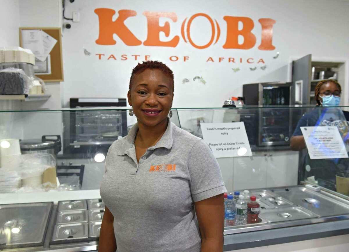Owner Kenichi Nwagboso stands in front of the counter in Keobi. (Lori Van Buren/Times Union)