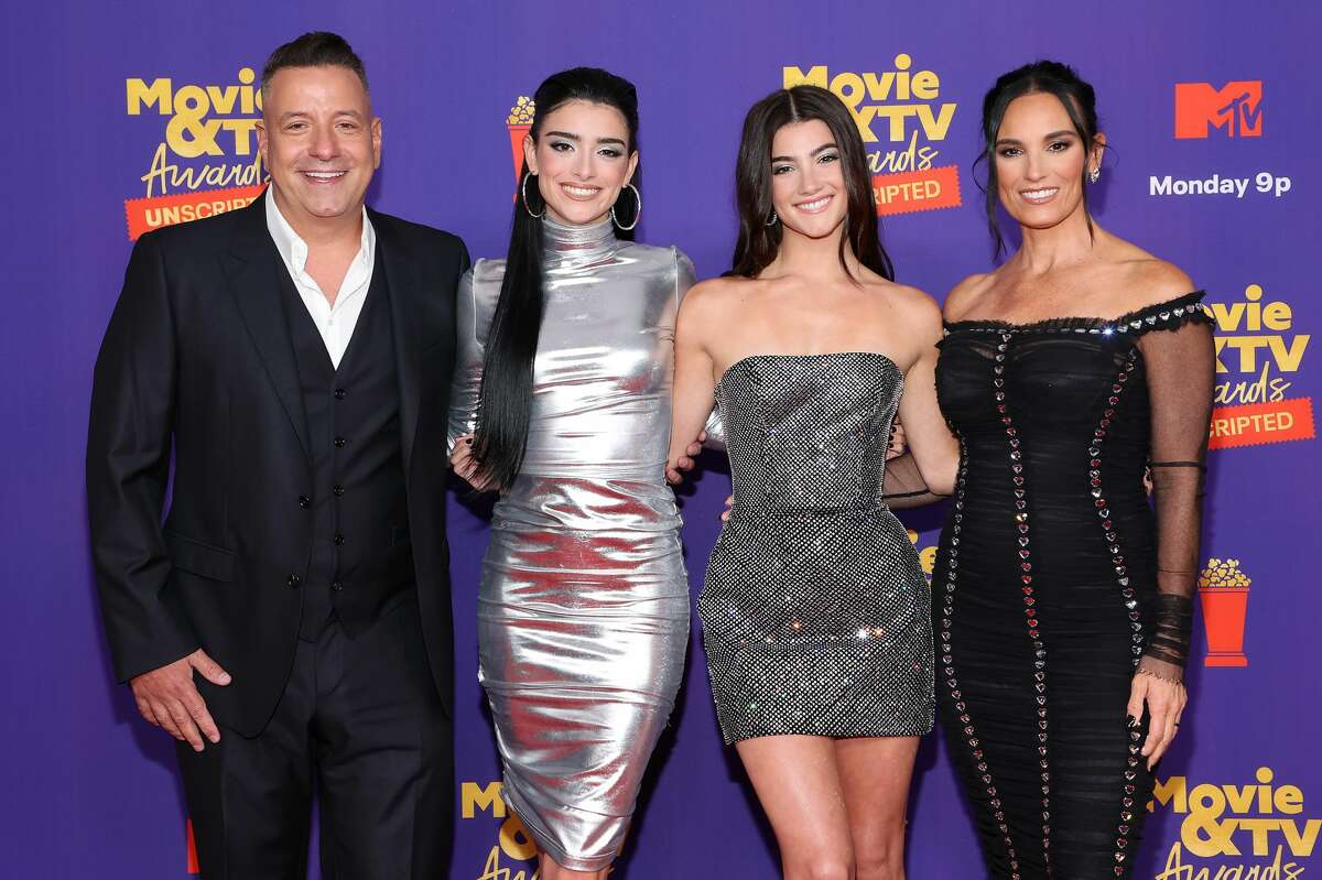 (L-R) Marc D'Amelio, Dixie D'Amelio, Charli D'Amelio and Heidi D'Amelio attend the 2021 MTV Movie & TV Awards: UNSCRIPTED in Los Angeles, California.