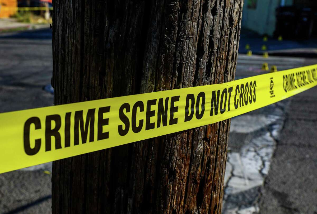 Crime scene tape is placed at School St. and Pleitner Ave. following a shooting on Friday, June 25, 2021, in Oakland, Calif. Oakland is shifting some money from the police budget over to violence prevention and other services.