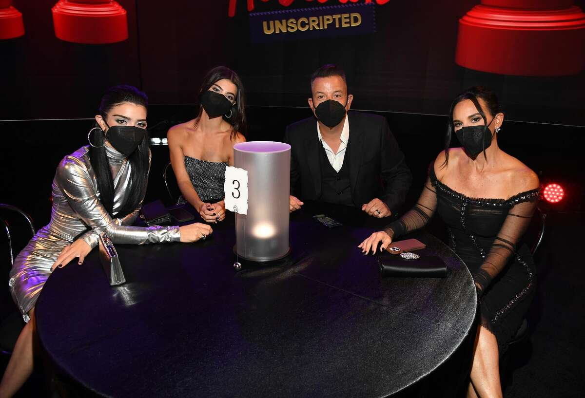 (L-R) Dixie D'Amelio, Charli D'Amelio, Marc D'Amelio, and Heidi D'Amelio pose during the 2021 MTV Movie & TV Awards: UNSCRIPTED in Los Angeles, California.