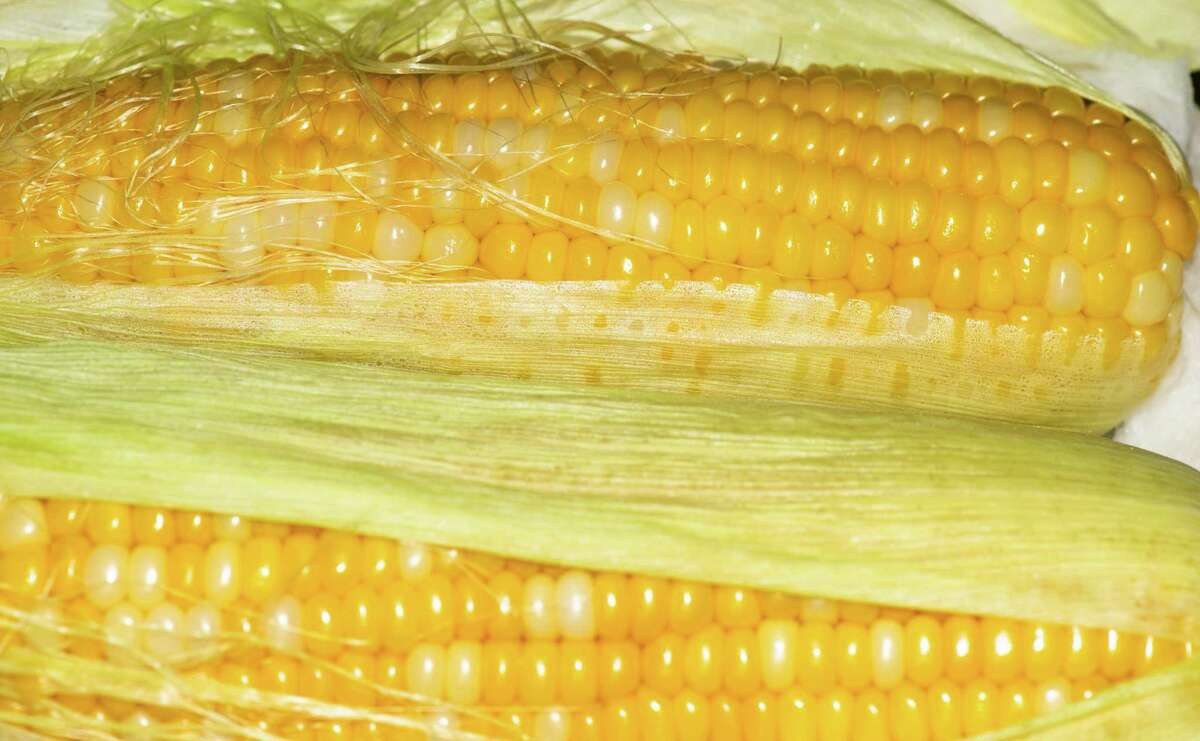 Ears of corn cooked in their husks in the microwave will remain more plump and juicy, be simpler to peel and easier to cut whole, intact kernels from.