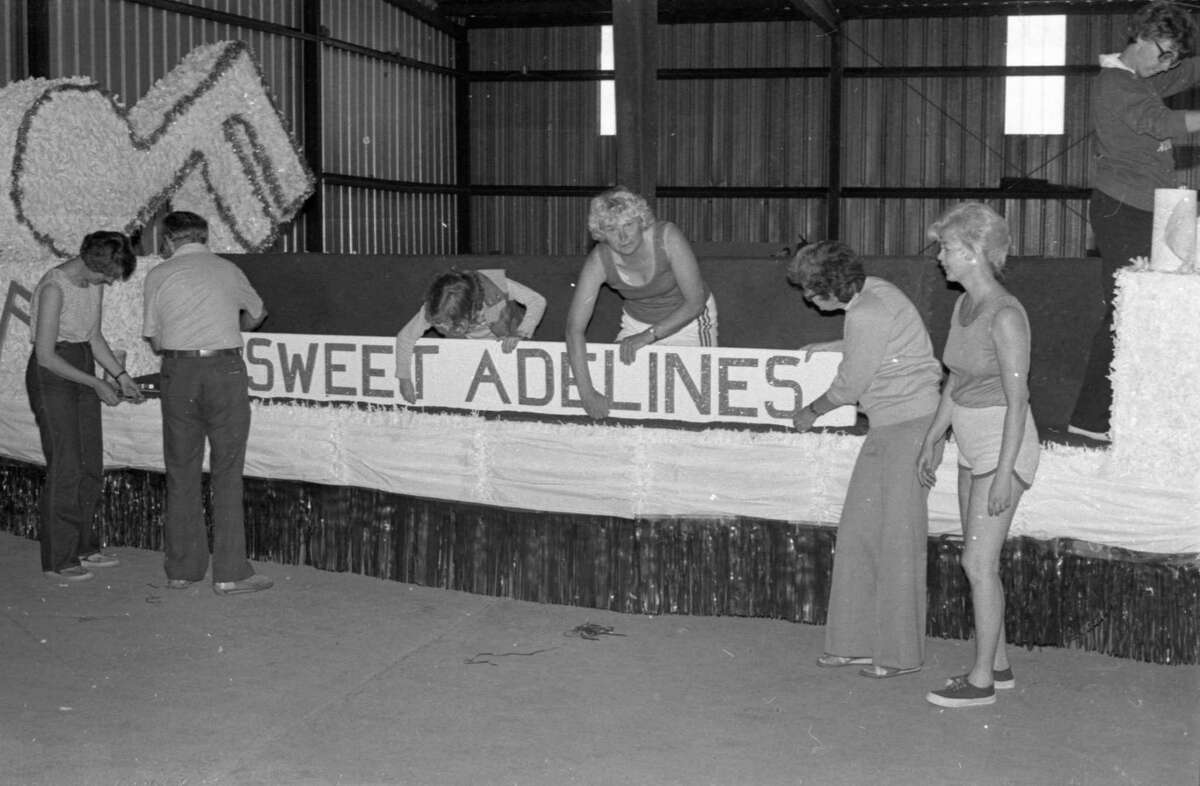 The Manistee National Forest Festival's grand Fourth of July parade is only a few days away and the local Sweet Adelines singing group is busy working on their float to finish it up before the holiday. Shown are Sally Burmeister, Wes Kooyers, Vicki Green, Nancy Johnson, Joyce Kooyers, Bonnie Swidorski and Nancy Reed. The photo was published in the News Advocate on July 1, 1981. (Manistee County Historical Museum photo)