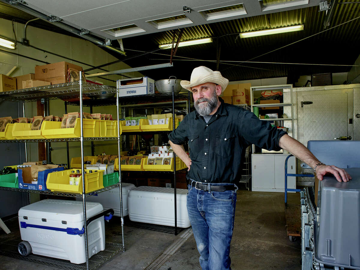 """""""One thing the film business has taught me is to roll with and react to whatever arises and keep things moving and keep it efficient,"""" says George Billard, a Barryville film producer turned founder of the food delivery service, Fresh Catskills. The company operates out of a warehouse in Monticello, pictured, and is hiring."""