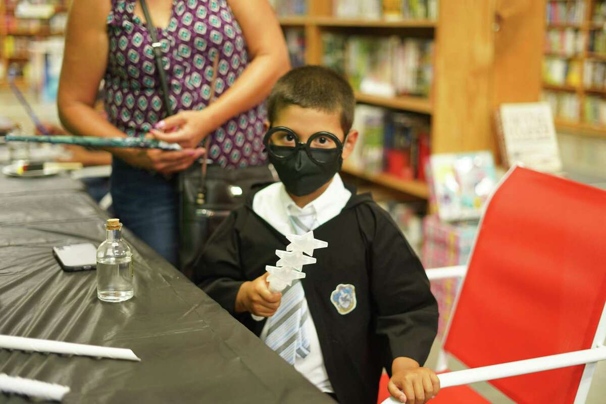 Laredo's Joshua Richards dressed as Harry Potter for the Harry Potter Book Night at Book Market.