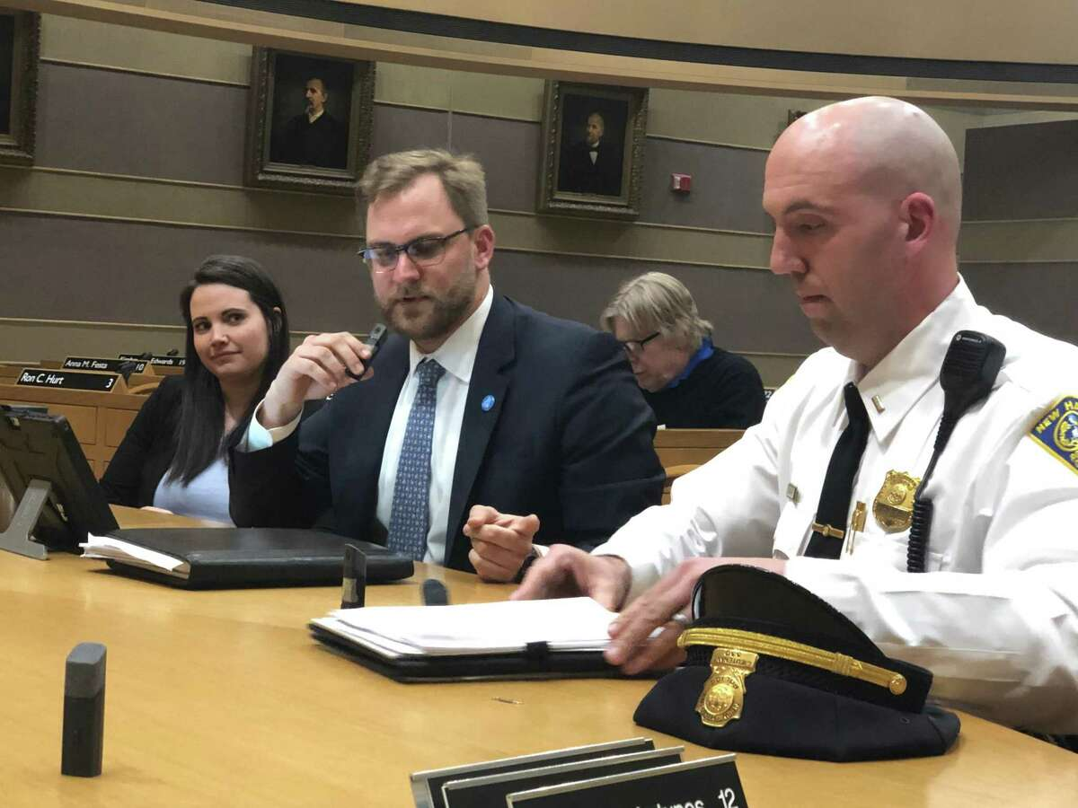 Karla Lindquist, acting deputy director of the New Haven Department of Transportation, Traffic and Parking, Doug Hausladen, director, and police Lt. Sean Maher speak at a Board of Alders' Public Safety Committee hearing.