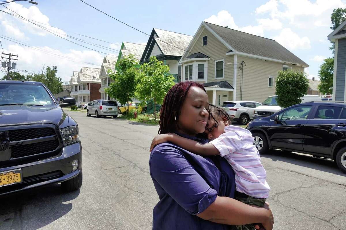 Ifrecak Miller holds her son Osaze Edwards, 3, as she stands just down the street from her home on Lincoln Ave. on Sunday, June 27, 2021, in Schenectady, N.Y. (Paul Buckowski/Times Union)