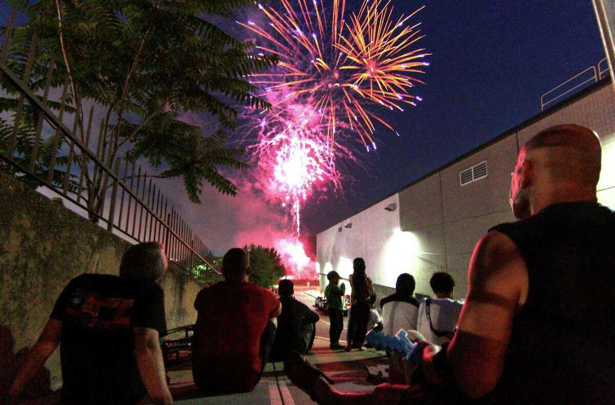 The July 4th holiday fireworks display is held at Veterans Memorial Park in Shelton, Conn., on Wednesday July 8, 2020. Due to the coronavirus pandemic, crowds weren't allowed to gather in the park, but were able to watch from the roads and homes nearby.