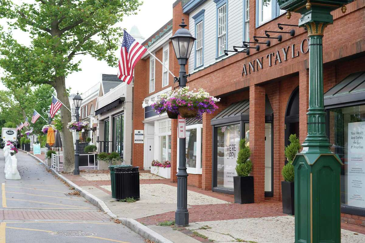 """In keeping with tradition, flags wave on Elm Street in New Canaan, as the town gets ready to celebrate the Fourth of July with a virtual celebration.""""God Bless America"""" will be sung by rising New Canaan High School senior Megan Lydon before a 24-minute video of last year's firework display on Channel 79 (NCTV79) .The presentation will be shown on the hour at 3 p.m., 5 p.m., 7 p.m. and 9 p.m. on Friday, Saturday and Sunday, July 3-5."""