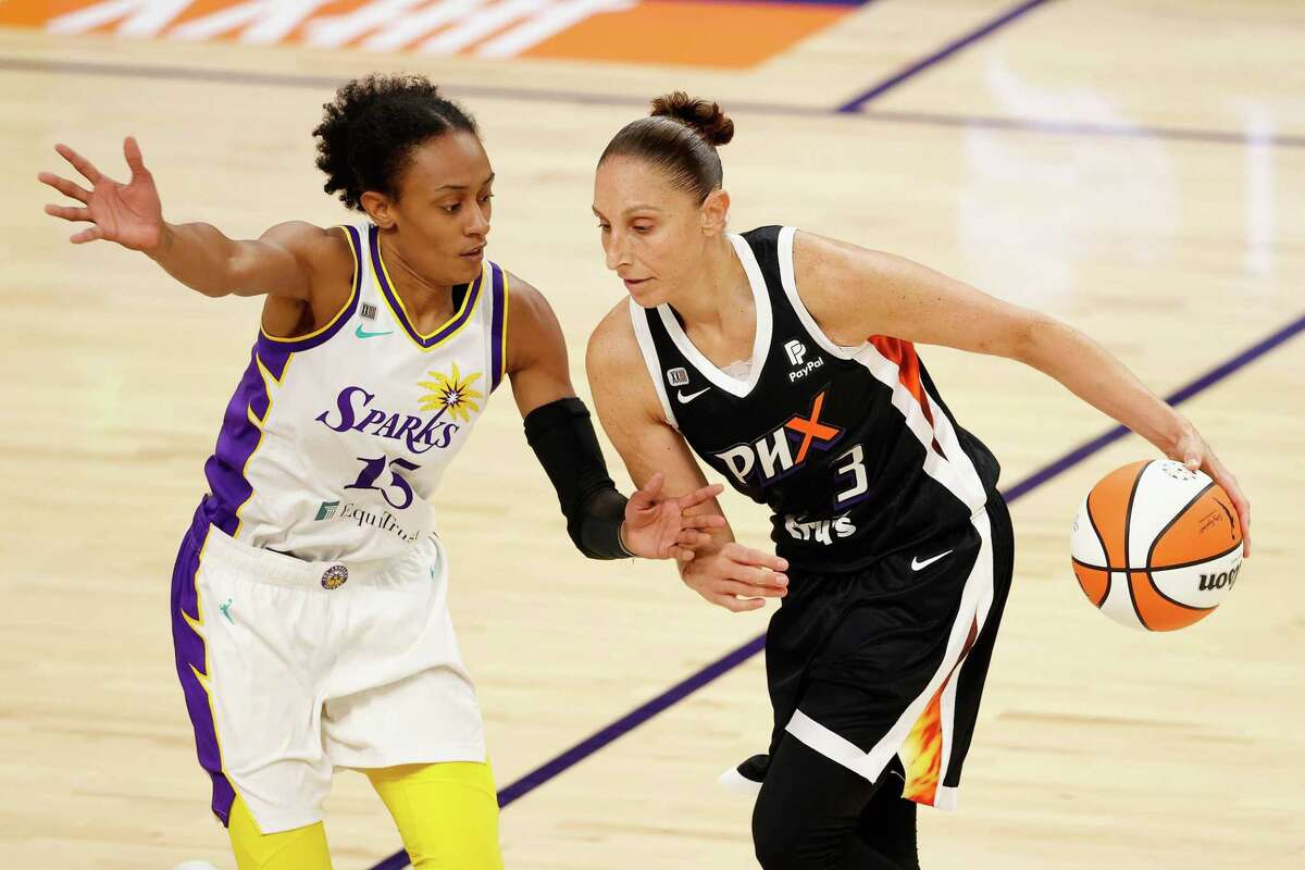 PHOENIX, ARIZONA - JUNE 27: Diana Taurasi #3 of the Phoenix Mercury handles the ball against Brittney Sykes #15 of the Los Angeles Sparks during the first half of the WNBA game at Phoenix Suns Arena on June 27, 2021 in Phoenix, Arizona. NOTE TO USER: User expressly acknowledges and agrees that, by downloading and or using this photograph, User is consenting to the terms and conditions of the Getty Images License Agreement. (Photo by Christian Petersen/Getty Images)