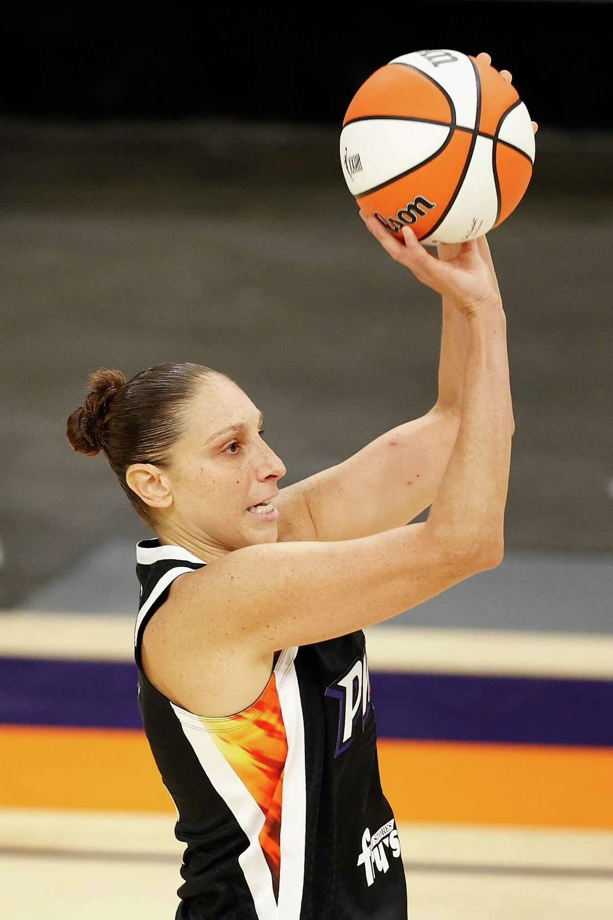 PHOENIX, ARIZONA - JUNE 27: Diana Taurasi #3 of the Phoenix Mercury attempts a three-point shot against the Los Angeles Sparks during the second half of the WNBA game at Phoenix Suns Arena on June 27, 2021 in Phoenix, Arizona. NOTE TO USER: User expressly acknowledges and agrees that, by downloading and or using this photograph, User is consenting to the terms and conditions of the Getty Images License Agreement. (Photo by Christian Petersen/Getty Images)
