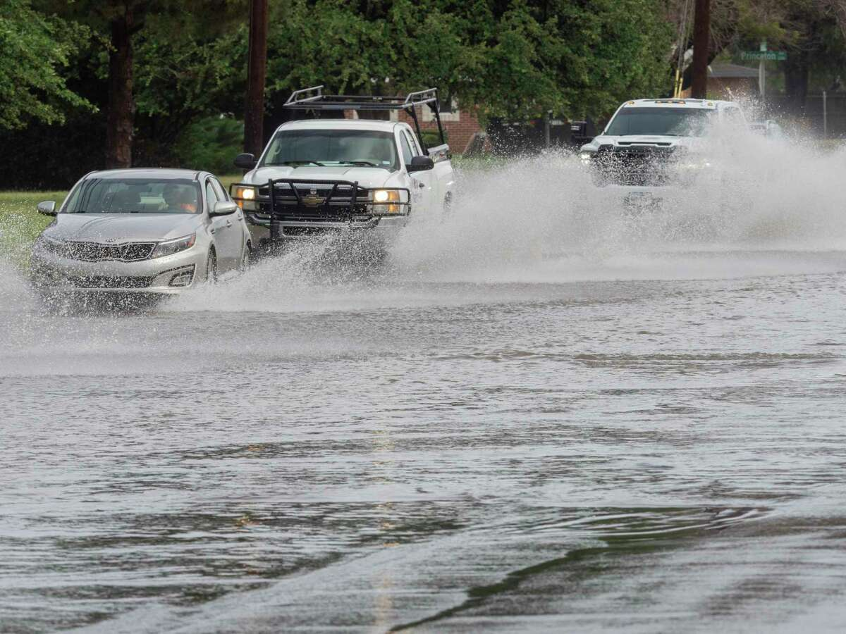 Continuing rains have inundated area roadways and parks designated as runoff areas 06/28/2021 morning as cars travel along Garfield north of Cuthbert Ave. Tim Fischer/Reporter-Telegram