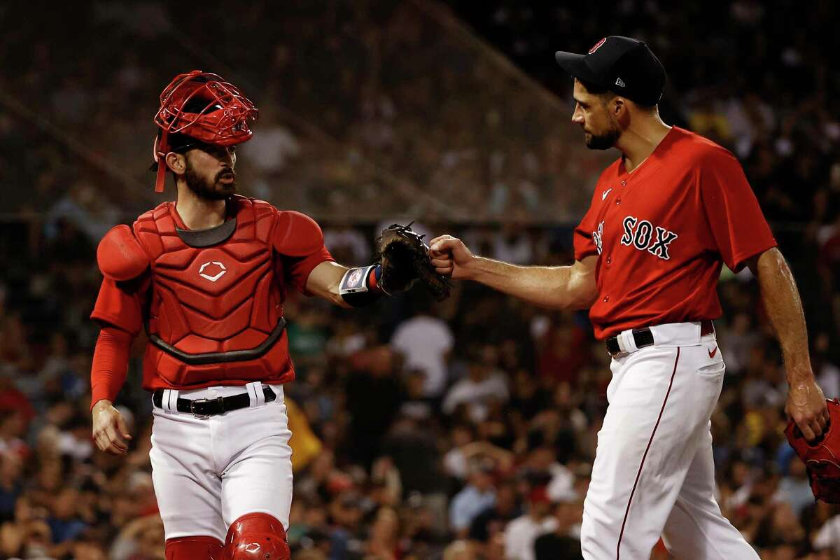 Pearland's Connor Wong (left) of the Boston Red Sox congratulates Alvin's Nathan Eovaldi after Eovaldi retired the side in the fifth inning against the New York Yankees Saturday at Fenway Park. Wong also collected his first Major League Baseball hit in the game.