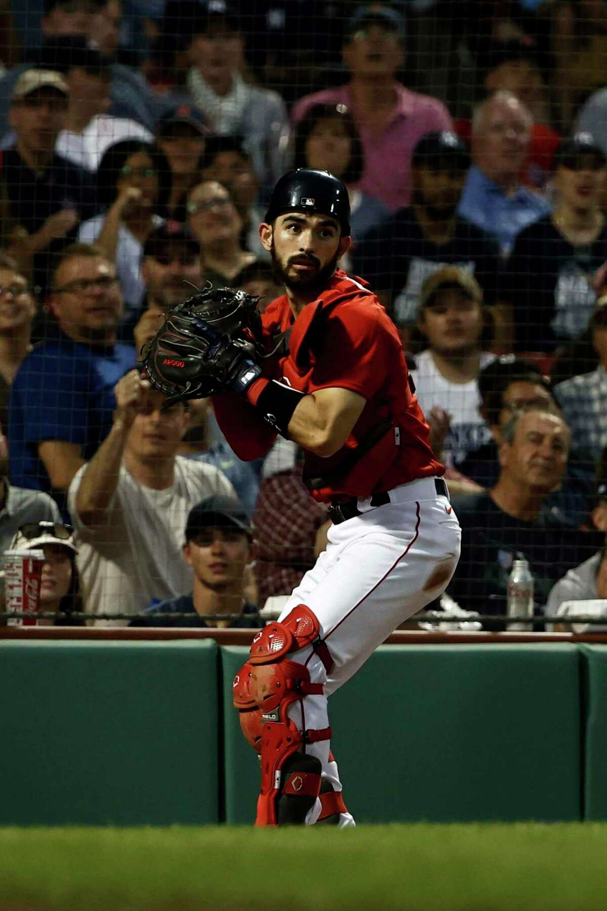 BOSTON, MA - JUNE 26: Catcher Connor Wong #74 of the Boston Red Sox checks base runners after gathering in a wild pitch during the fourth inning against the New York Yankees at Fenway Park on June 26, 2021 in Boston, Massachusetts. (Photo By Winslow Townson/Getty Images)