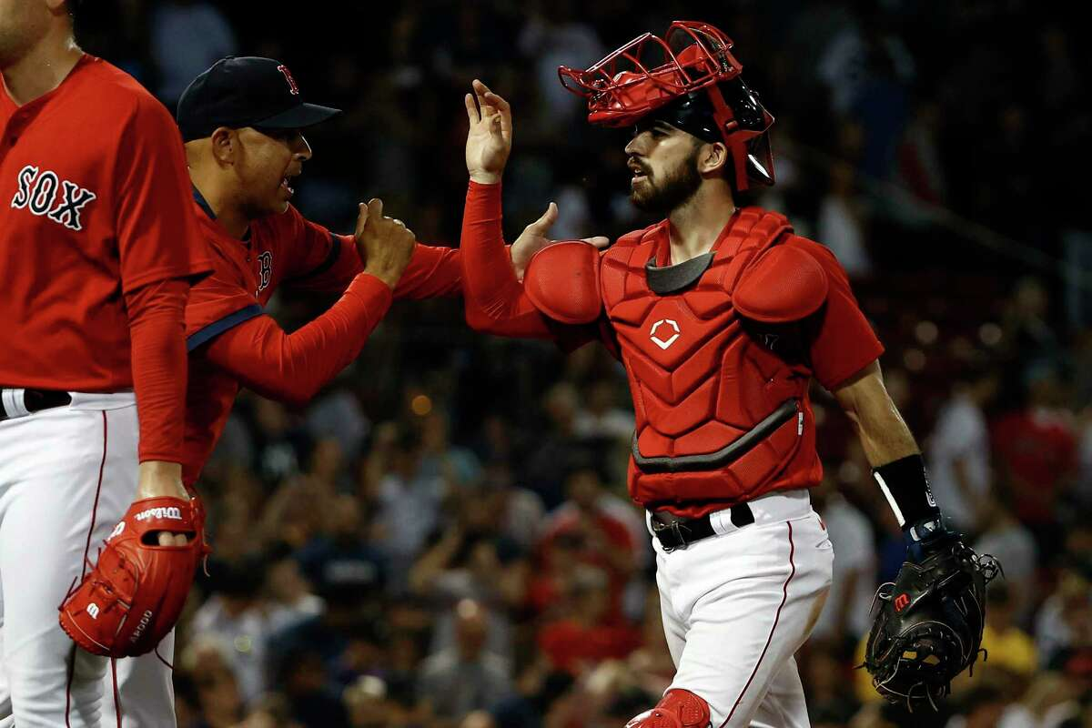 BOSTON, MA - JUNE 26: Manager Alex Cora #13 of the Boston Red Sox congratulates Connor Wong #74 of the Boston Red Sox after they defeated the New York Yankees 4-2 at Fenway Park on June 26, 2021 in Boston, Massachusetts. (Photo By Winslow Townson/Getty Images)