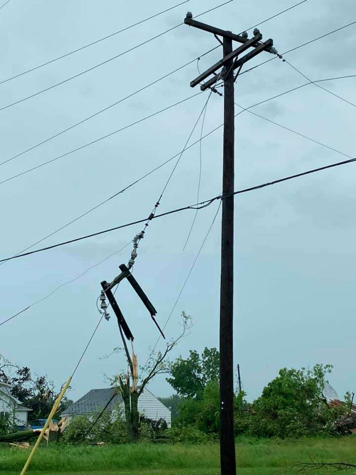 A submitted photo from a Tribune reader shows the damage some power lines in Port Austin faced after a tornado went through the area on Saturday. A DTE spokesperson said power would be restored to those without power by the end of Monday. (Courtesy Photo)