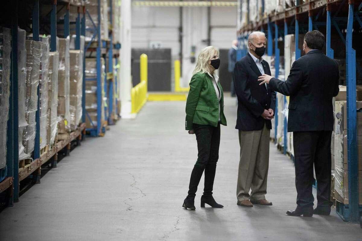 President Joe Biden and First Lady Jill Biden tour the Houston Food Bank with CEO Brian Greene Friday, Feb. 26, 2021 in Houston.