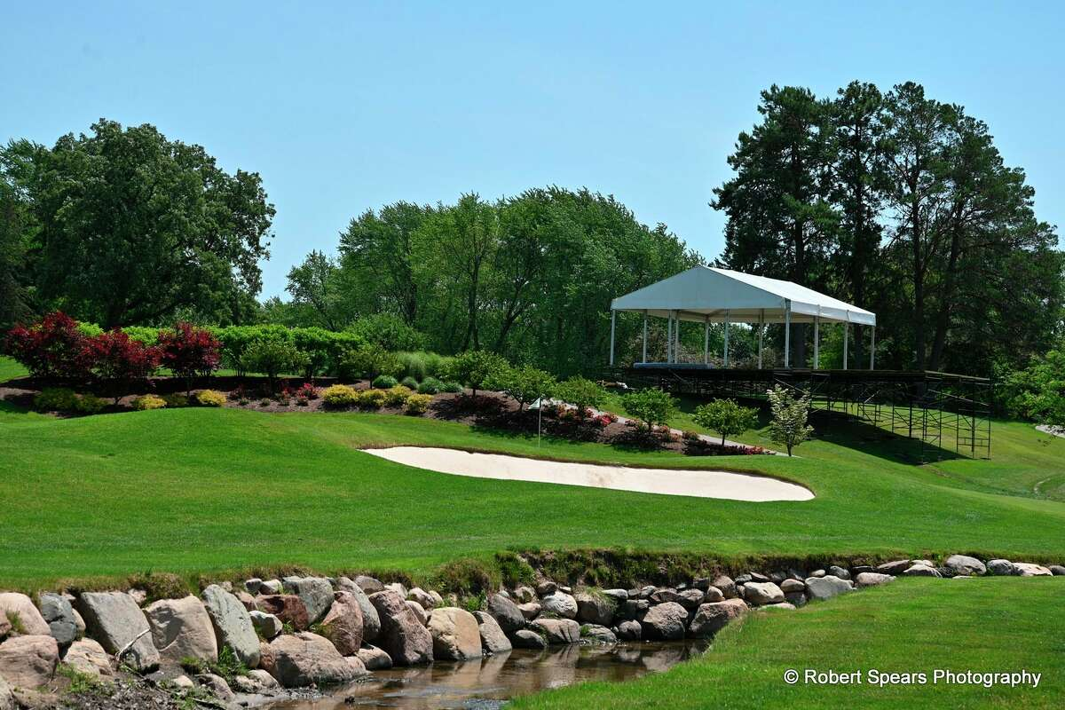 Work was under way last week at the Midland Country Club to set up tents and seating areas in preparation for the Dow Great Lakes Bay Invitational to be held from July 12-17. (Robert Spears Photography)
