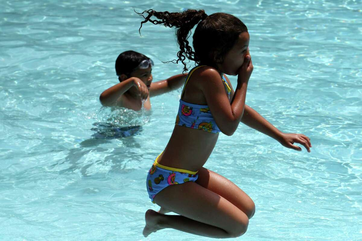 Emilia, 7, takes a jump into the Watervliet Municipal Pool after it opened for the season on Monday, June 28, 2021, on Second Avenue in Watervliet, N.Y. The pool was closed last year due to the pandemic. (Will Waldron/Times Union)