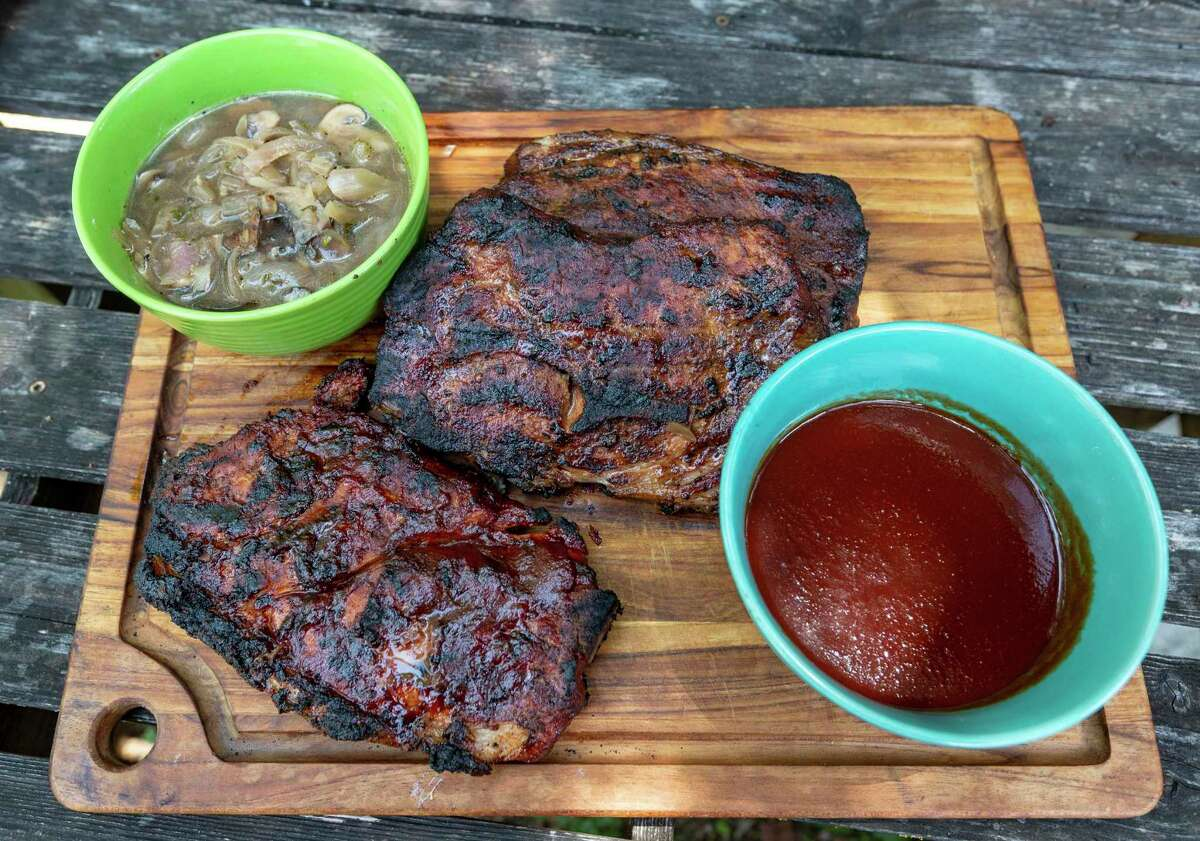 Smoked Pork Steaks with two mopping sauces: vinegar vegetable mix (top left) and a commercial bourbon barbecue blend