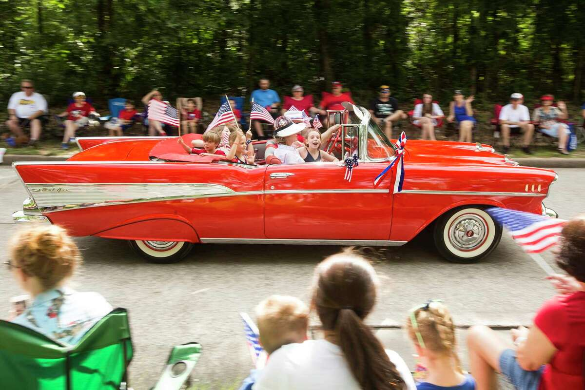 Classic cars roll down West Lake Houston Parkway during the a previous Independence Day parade in Kingwood.