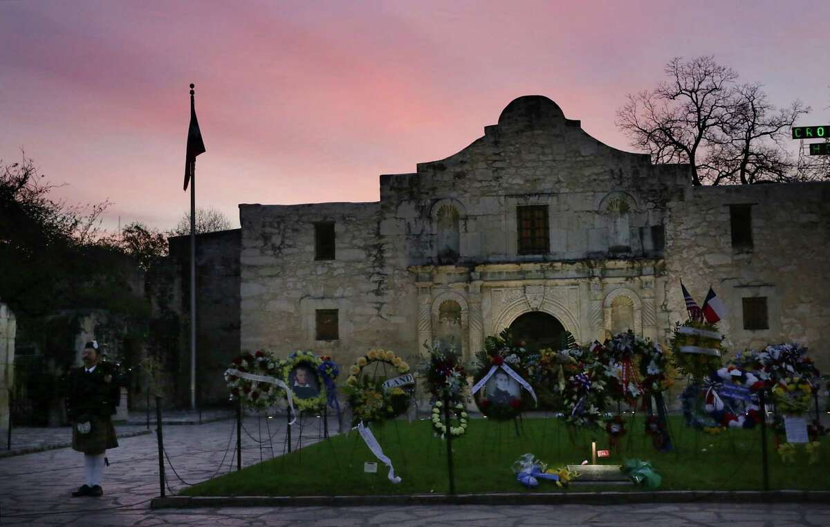 The sun rises during the annual Dawn at the Alamo ceremony, held on the anniversary of the 1836 battle, in 2019.