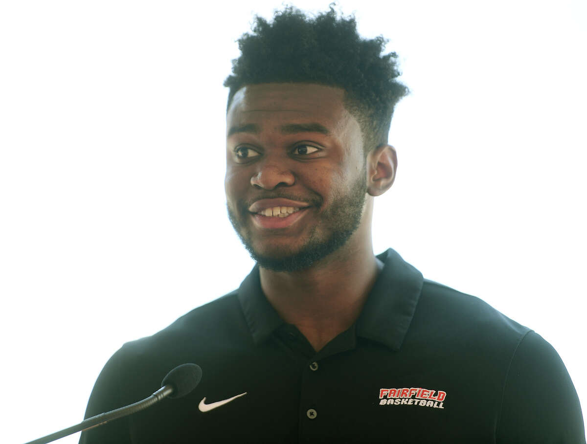 Fairfield University basketball player Taj Benning addresses the groundbreaking ceremony for the school's new arena and convocation center on the school's campus in Fairfield, Conn. on Monday, June 28, 2021.