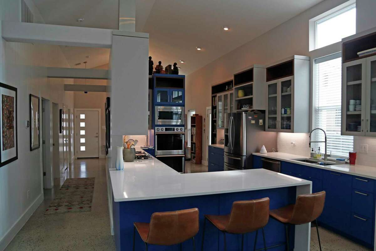 The heart of the home is the large, central kitchen, open to the 16-foot cathedral ceiling above.