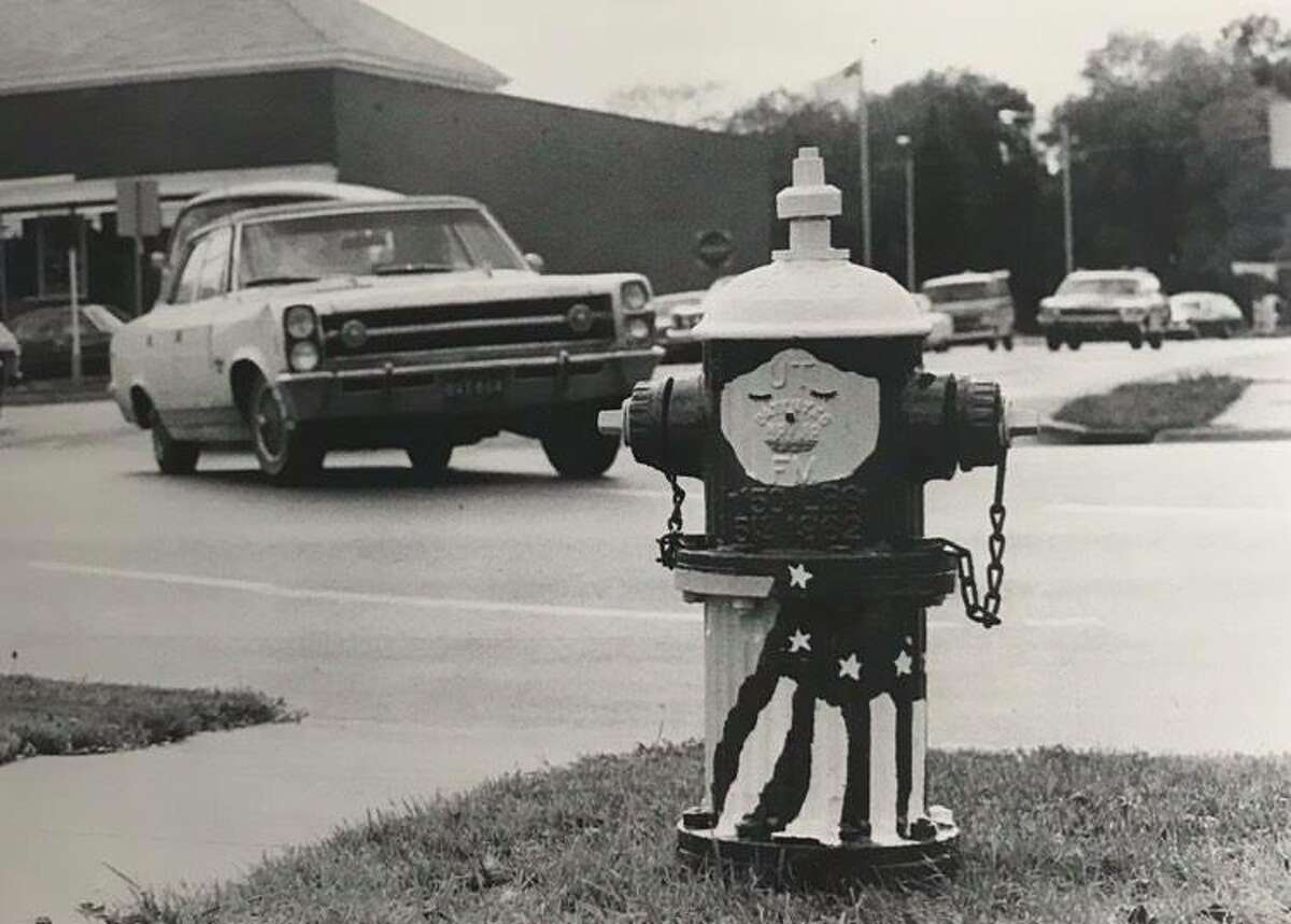 Uncle Sam is represented on a fire hydrant. October 1975