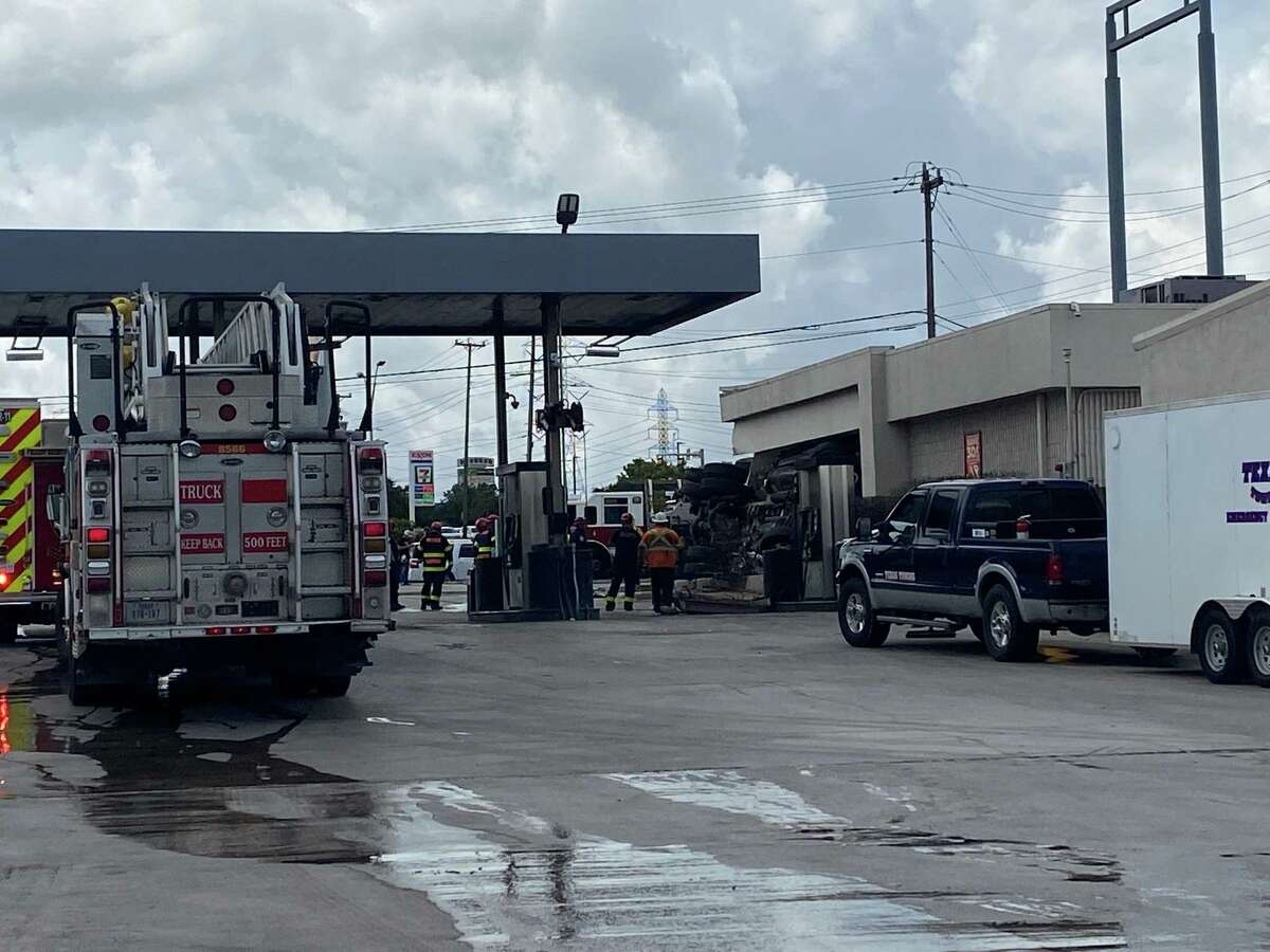 An 18-wheeler crashed into a Northeast Side gas station on Monday, sending three to the hospital.