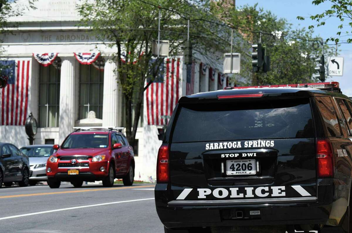 A Saratoga Springs police car is parked on Lake Avenue outside the station on Monday, June 28, 2021, in Saratoga Springs, N.Y. Four people were robbed and assaulted in a parking lot on Lake Avenue Oct. 2, 2021 by a group they were arguing with earlier in the evening, police said. (Will Waldron/Times Union)