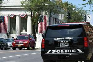 A Saratoga Springs police car is parked on Lake Avenue outside the station  on Monday, June 28, 2021, in Saratoga Springs, N.Y. The city is looking at ways to combat a recent upturn of violence.  (Will Waldron/Times Union)