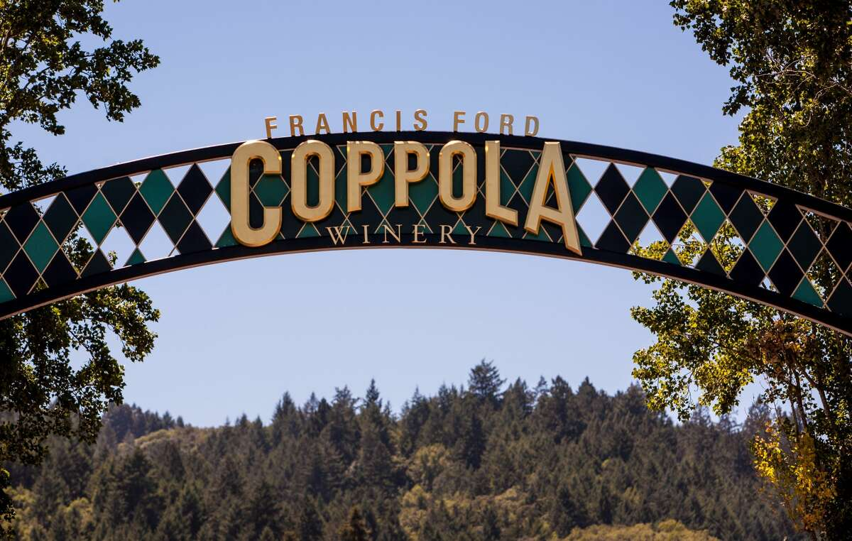 FILE - Warm sunny days are attracting Wine Country visitors to Francis Ford Coppola Winery on July 13, 2013, near Geyserville, California. Coppola has sold off his wine portfolio to another family-owned wine business.