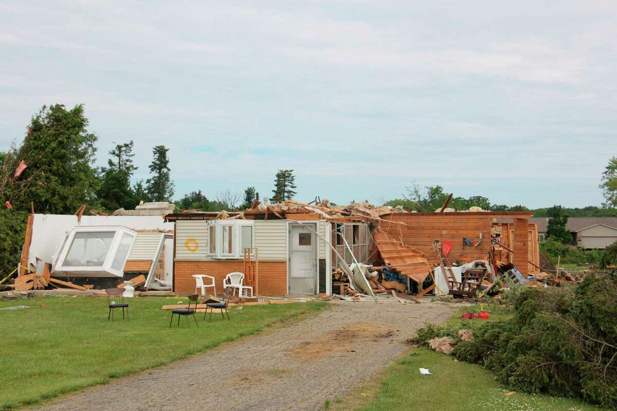 A home near the intersection of Independence Road and M-25 suffered heavy damage during Saturday's tornado in Port Austin. (Teresa Homsi/Huron Daily Tribune)