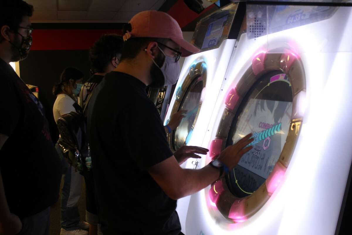 Several people were playing at Otaku Cafe's arcade Monday afternoon.