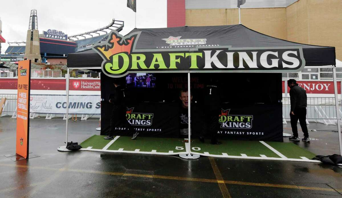 A Draft Kings tent in the parking lot of Gillette Stadium before an NFL football game between the New England Patriots and New York Jets, Sunday, Oct. 25, 2015, in Foxborough, Mass.