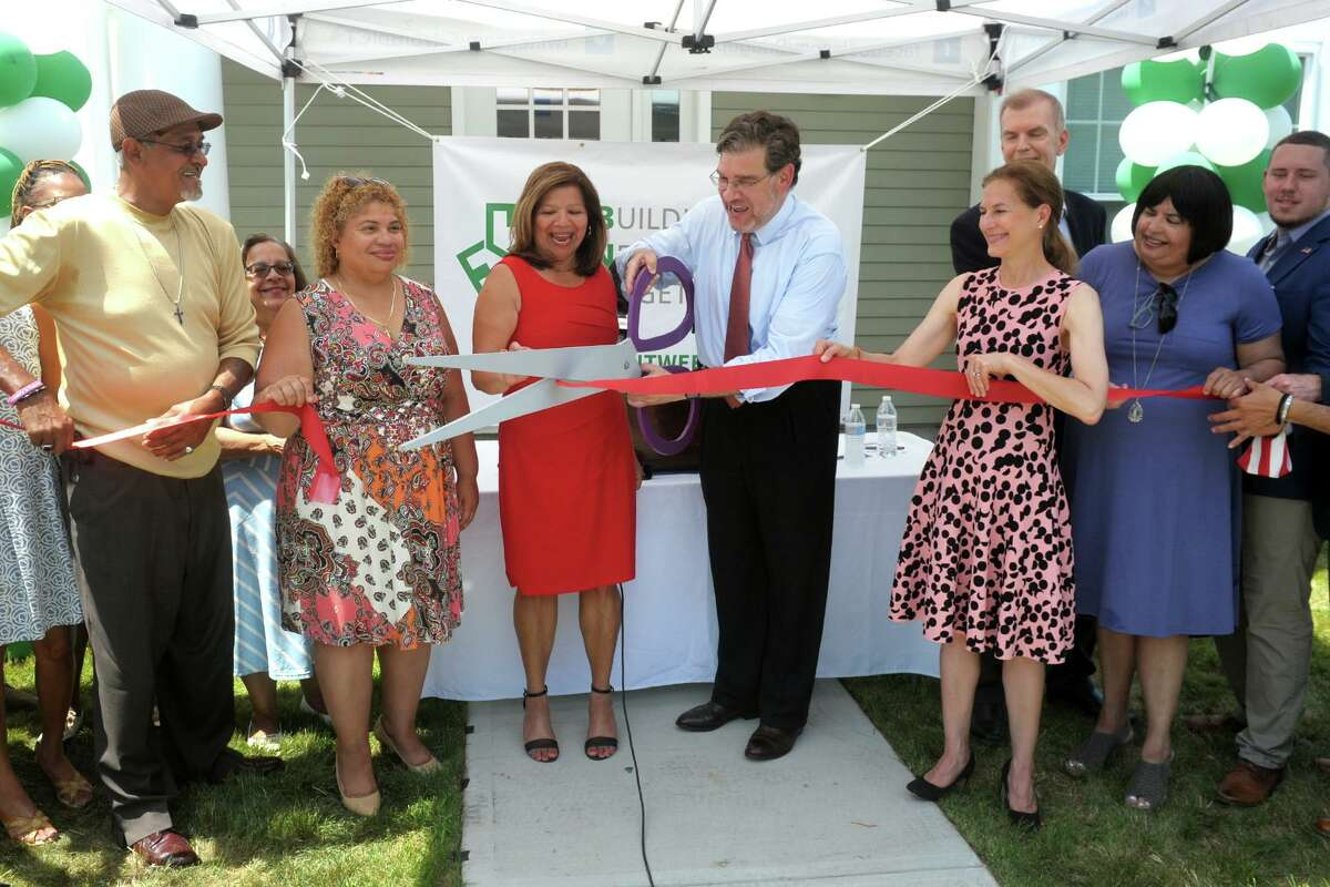 Noah Gotbaum, CEO of Building Neighborhoods Together (BNT), is joined by Lt. Governor Susan Bysiewicz, State Housing Commissioner Seila Mosquera-Bruno and others for a ribbon cutting ceremony for West Liberty Commons, in Bridgeport, Conn. June 28, 2021.
