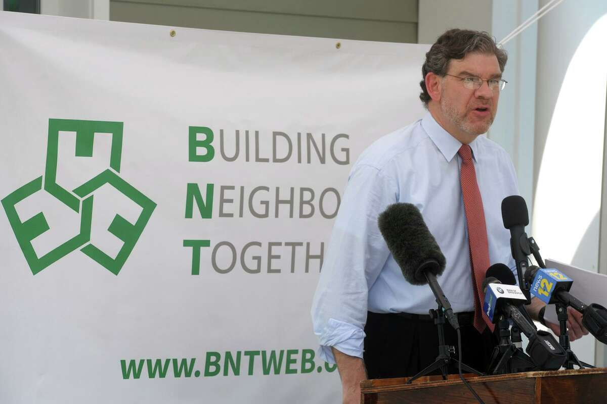 Noah Gotbaum, CEO of Building Neighborhoods Together (BNT), speaks during a ribbon cutting ceremony for West Liberty Commons, in Bridgeport, Conn. June 28, 2021.