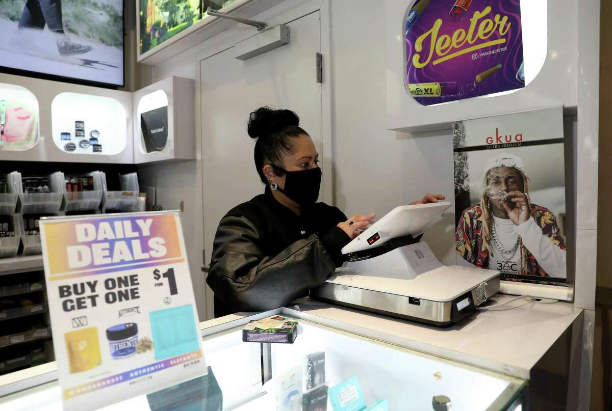 Cindy De La Vega, the first Latina dispensary owner in San Francisco, works inside her store, STIIIZY Union Square, on in San Francisco, Calif. At a time when so many other businesses were closing down, cannabis in San Francisco has seen an enormous boom. Permits for dispensaries were off the chart during the last year, and at least 10 storefronts have opened in the last year, even though cannabis as a whole got zero small business aid during the pandemic.