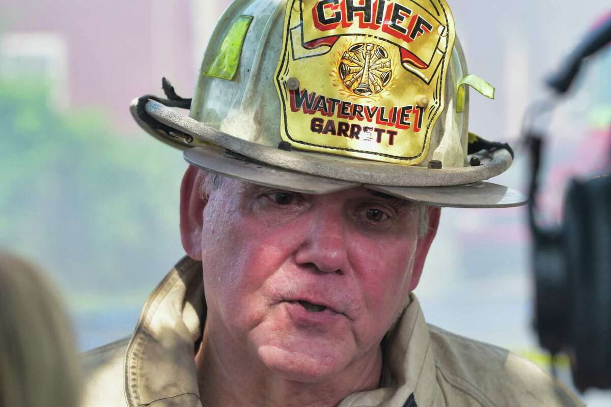 Watervliet Fire Chief Tom Garrett said a cigarette accidentally tossed on a pet bed ignited a fire Monday that spread to three row houses near theintersection of 24th Street and Broadway. (Paul Buckowski/Times Union)