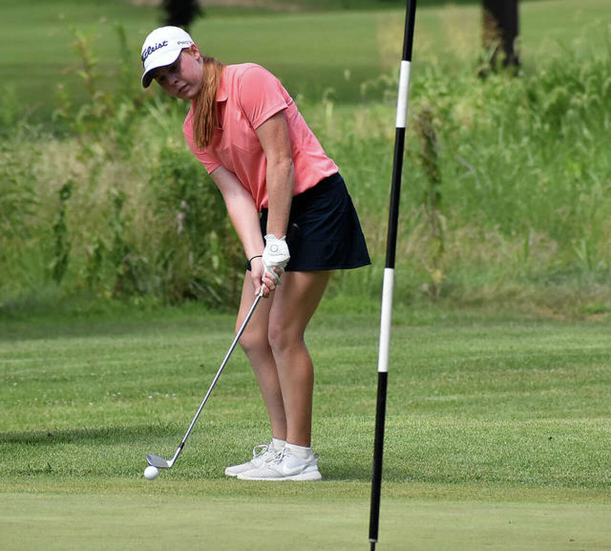 Riley Lewis hits a chip shot onto the green during an event at Spencer T. Olin Golf Course in 2020.