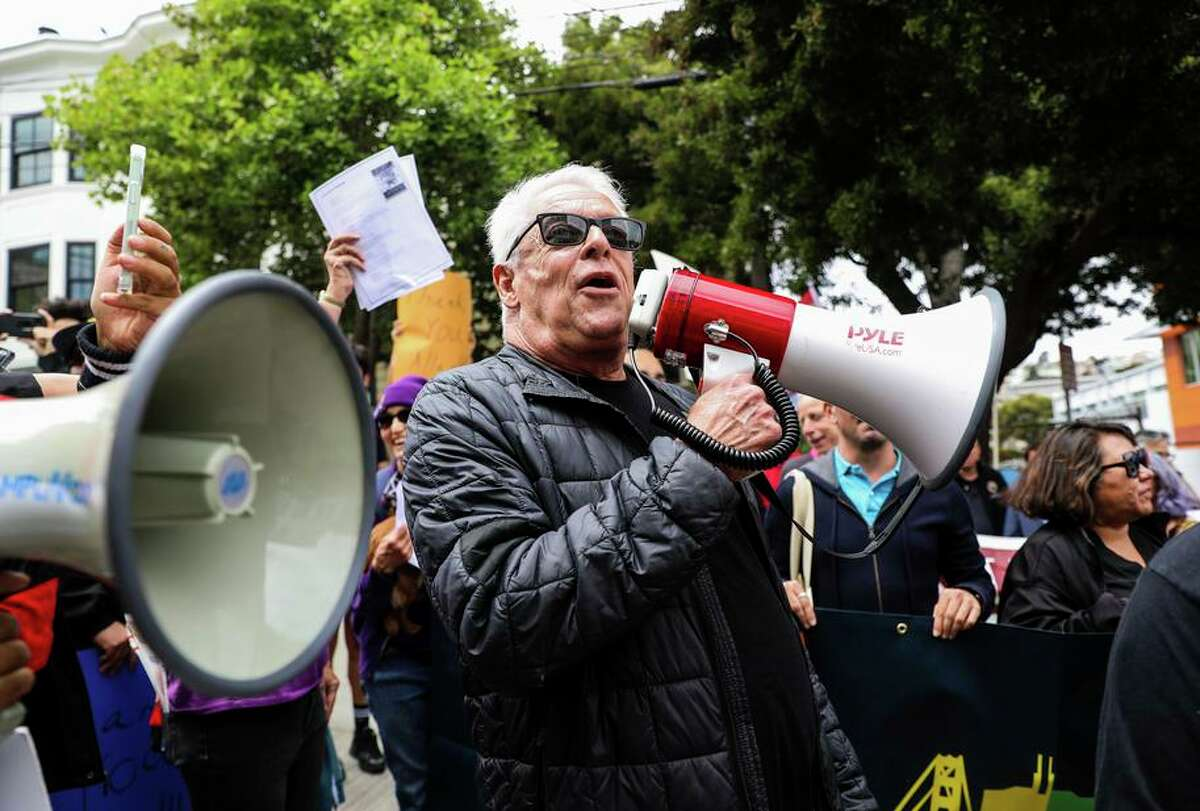 Cleve Jones uses a bullhorn to call out to Allan Baird, who gave Milk his own bullhorn, after leading a march honoring Baird for his commitment to labor and to the LGBTQ community.