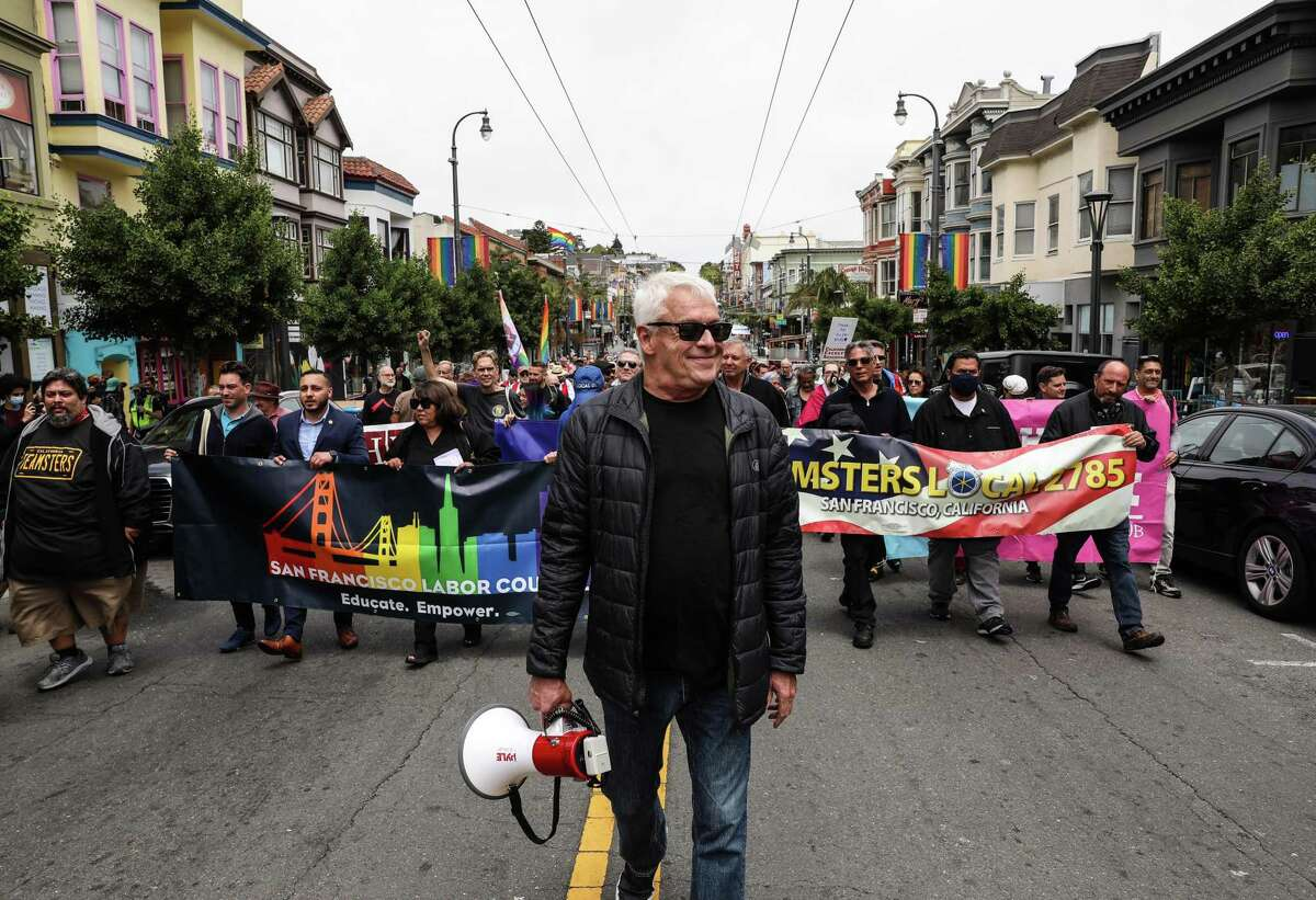 Cleve Jones leads a tribute march to Allan Baird on Castro Street.