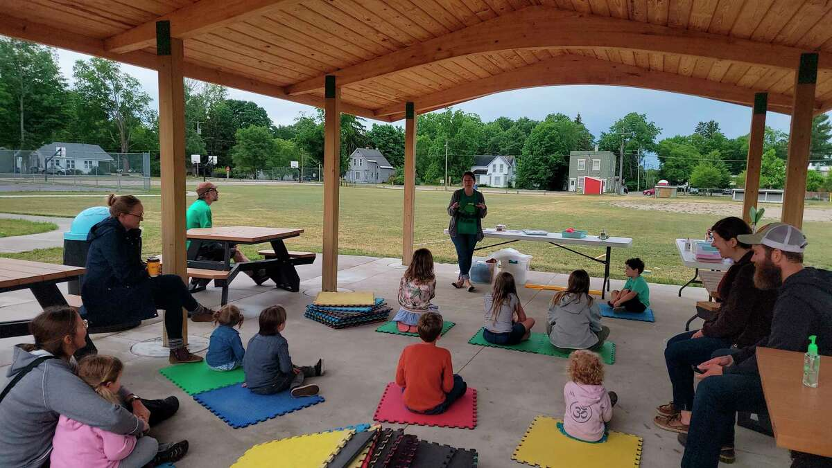 Children enjoy a summer reading program in Academy Park hosted by the Benzonia Public Library. (File Photo)