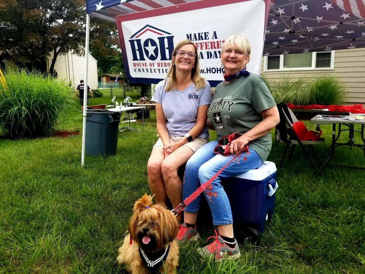 Carol May of House of Heroes Connecticut, left, and homeowner Robbin Wyatt Ford on Saturday.