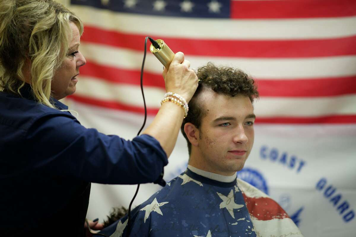 Nearly 300 new cadets join the U.S. Coast Guard Academy Monday in New London. The first day marks the start of swab summer, an intensive seven-week program that prepares students for military and academy life. The first day includes the new cadets receiving proper haircuts.