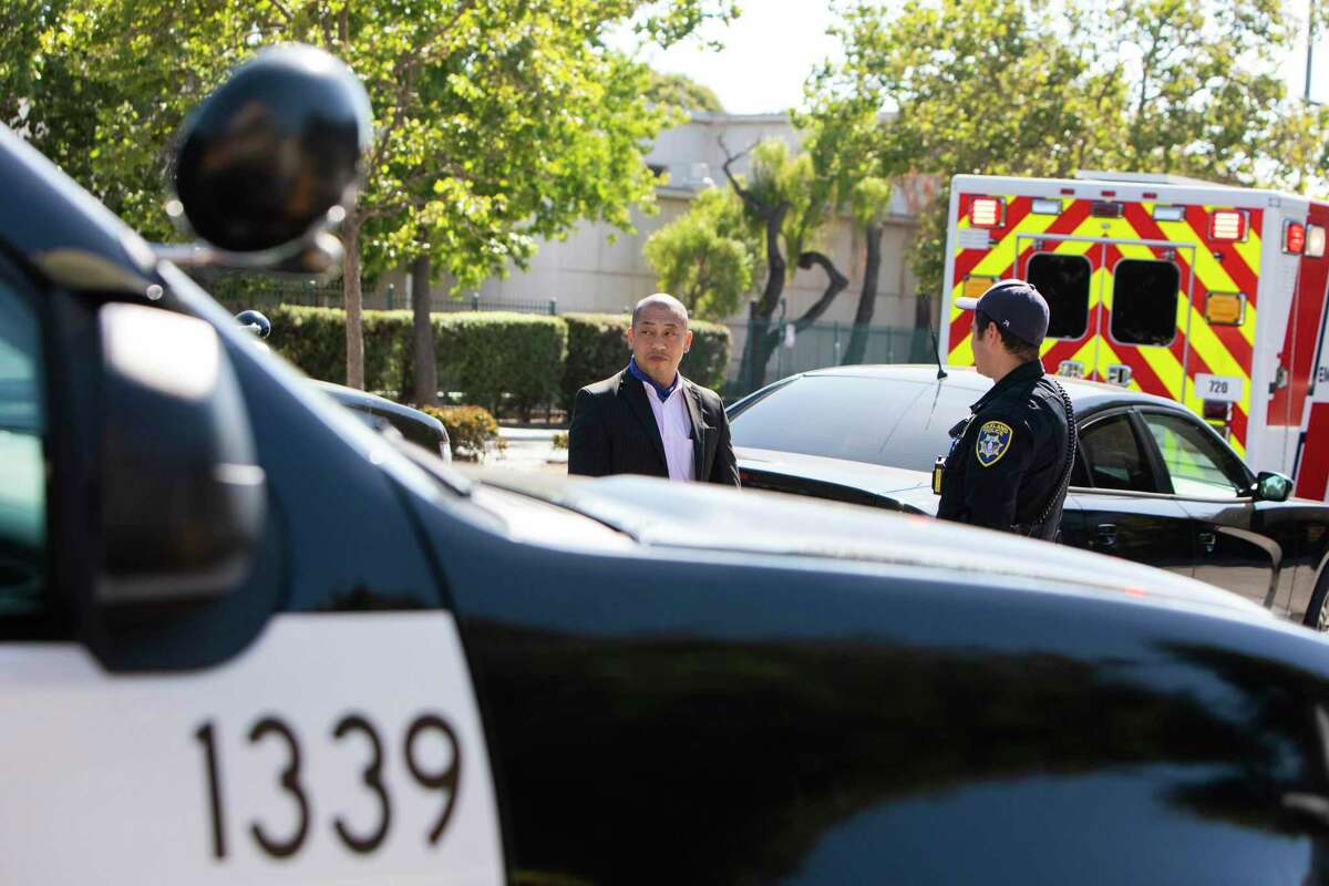 Phong Tran, an Oakland homicide investigator, leaves the crime scene on the 2200 block of Chestnut Street in Oakland, Calif., on Friday, June 25, 2021. One male was pronounced deceased on the scene after police responded to reports of a shooting in West Oakland.